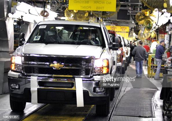 People work on a Chevy pickup truck on the assembly line of the General Motors Flint Assembly Plant January 24 2011 in Flint Michigan In response to...