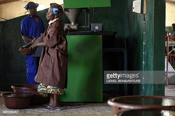 People work on a shea butter production line for the French cosmetics company L'Occitane in Leo southcentral Burkina Faso on January 24 2014...