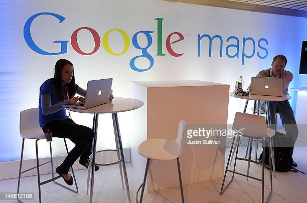People work on laptops before the start of a news conference about Google Maps on June 6 2012 in San Francisco California Google announced new...