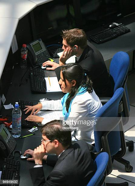 People work on the floor of the Mexican Stock Exchange or Bolsa Mexicana de Valores in Mexico City Mexico on Wednesday May 20 2009 Mexican stocks...