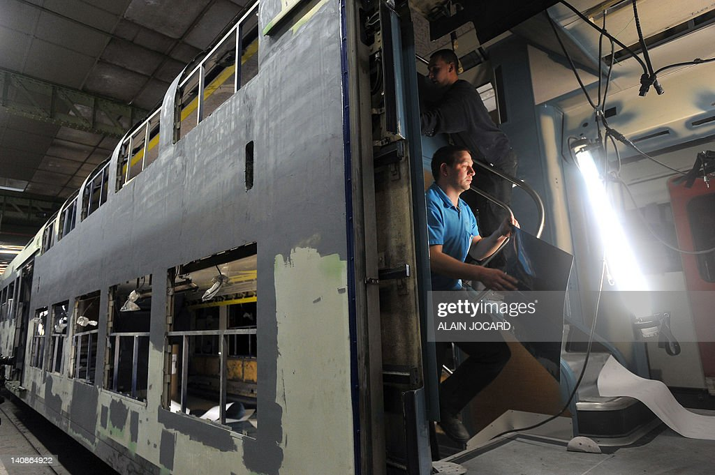 People work on the renovation of a double-decker train RER (Regional Express Network) serving Paris and its suburbs, on March 7, 2012 in Saint-Pierre-des-Corps, central France. AFP PHOTO /ALAIN JOCARD