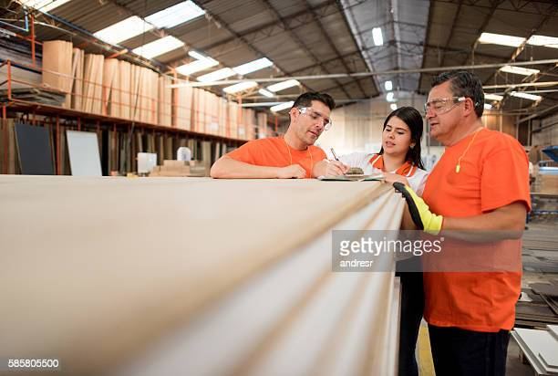 People working at a lumberyard
