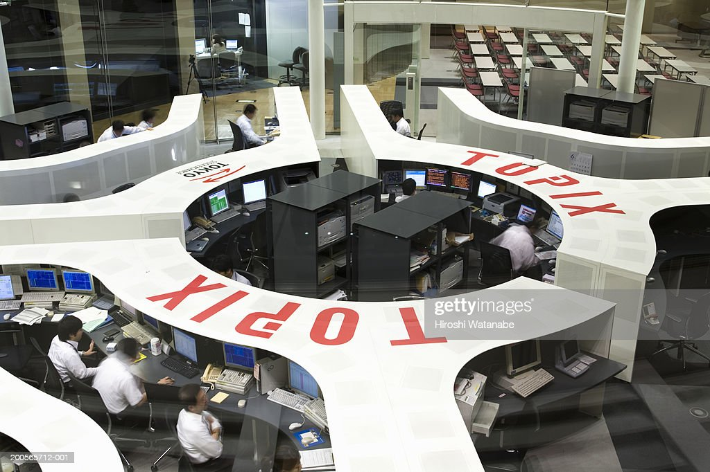 People working at stock exchange, elevated view