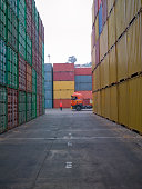 People working in a shipping yard