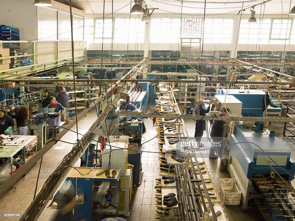People working in a shoe factory : Stock Photo