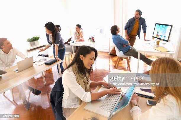 People working in busy office