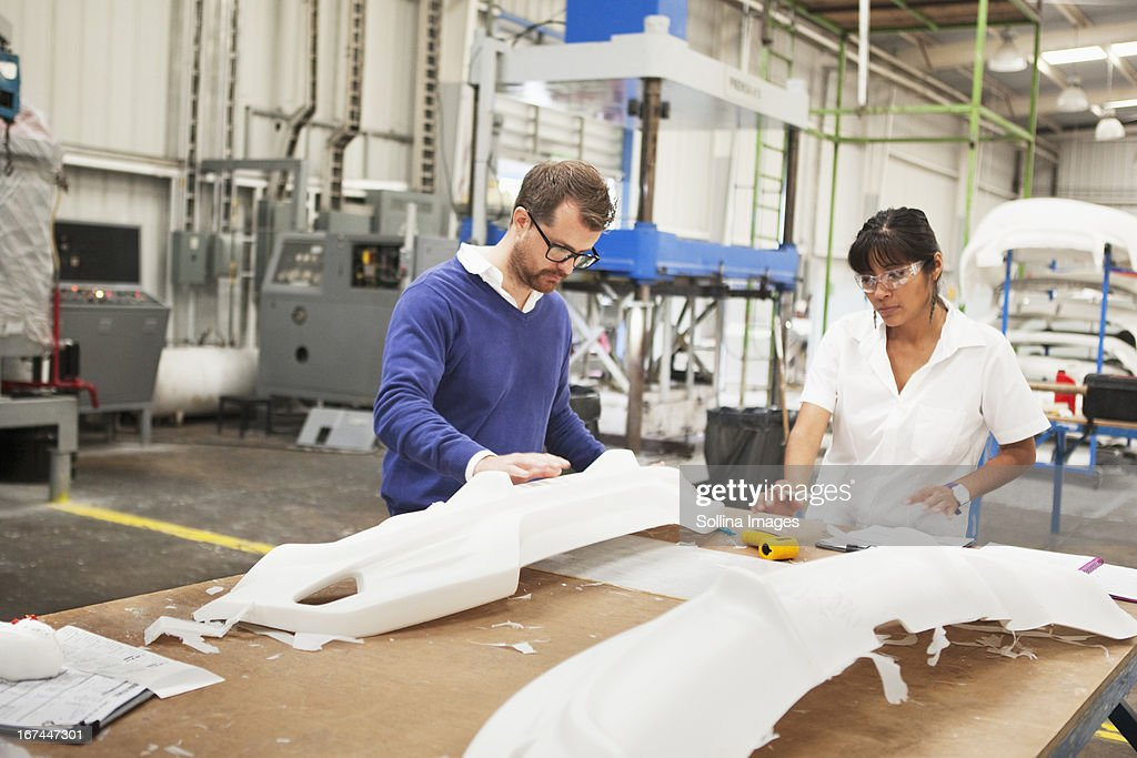 People working in manufacturing plant : Stock Photo