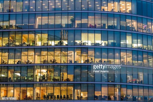 People working in offices, facade & windows, London, UK