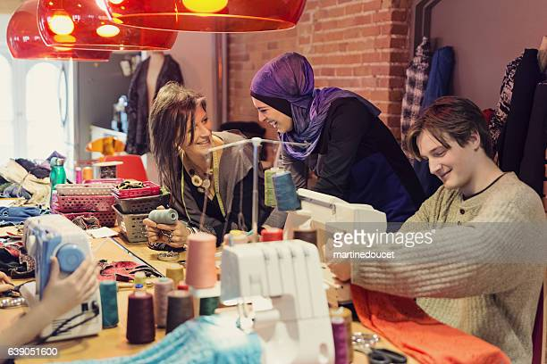 People working in small fashion enterprise lead by woman.