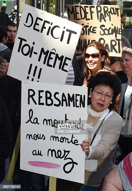 People working in the entertainment industry on shortterm contracts take part in a demonstration on April 10 2014 in front of the JoseCabanis media...