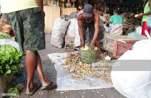 People working in the sale of Tucupi at Ver-o-Peso Market in Belém,Brazil