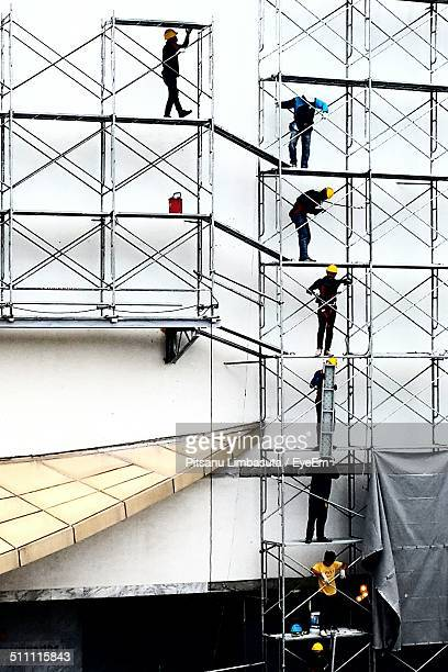 People working on scaffolding