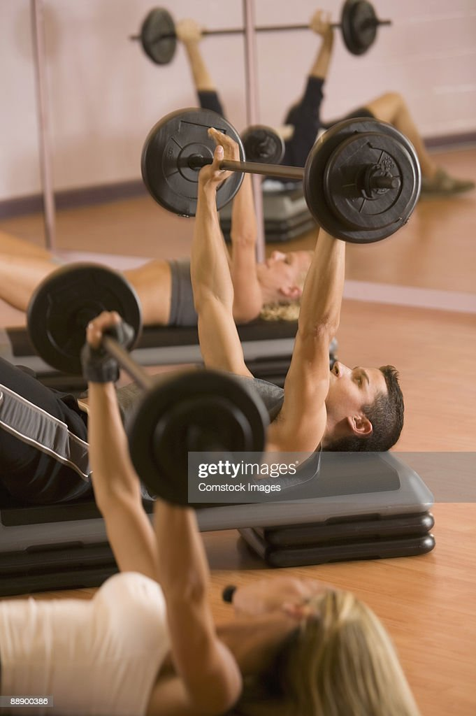 People working out with weights : Stock Photo
