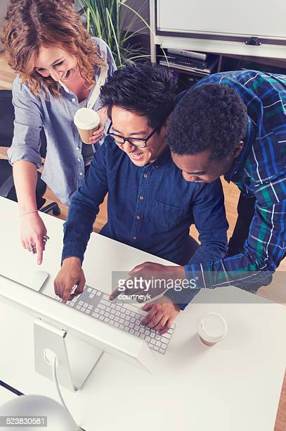 3 people working together in a small business office.