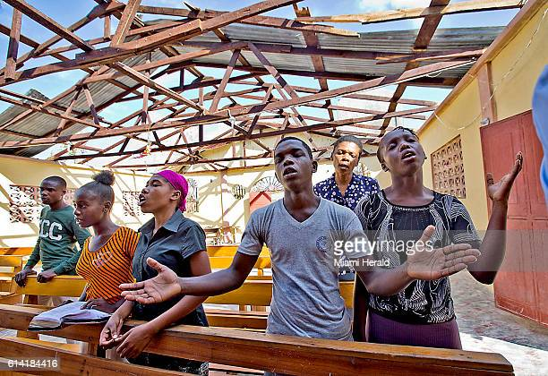 People worship on Sunday Oct 9 2016 at a church that's roof was lost in Hurricane Matthew in Port Salut Haiti