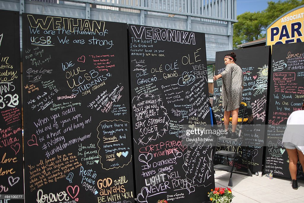 People write chalk messages on a memorial wall for slain students on the Day of Mourning and Reflection for the victims of a killing spree at University of California, Santa Barbara on May 27, 2014 in Isla Vista, California. Elliot Rodger killed six college students at the start of Memorial Day weekend and wounded seven other people, stabbing three then shooting and running people down in his BMW near UCSB before shooting himself in the head as he drove. Police officers found three legally-purchased guns registered to him inside the vehicle. Prior to the murders, Rodger posted YouTube videos declaring his intention to annihilate the girls who rejected him sexually and others in retaliation for his remaining a virgin at age 22.