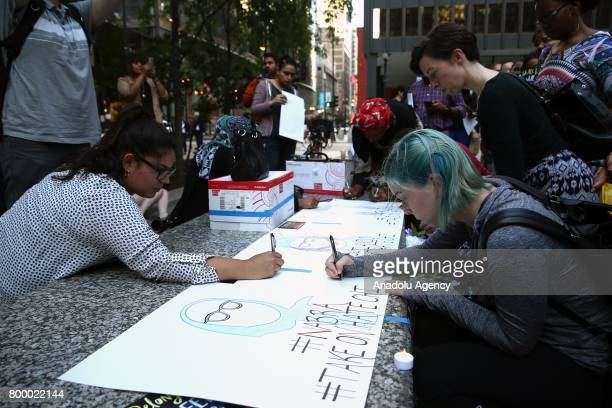 People write down messages during a commemoration ceremony at the Federal Plaza in Chicago IL United States on June 22 2017 for Nabra Hassanen who...
