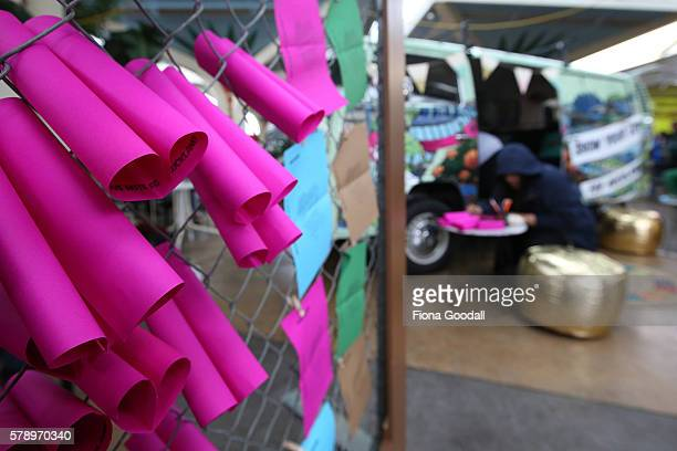 People write love notes to Auckland outside the Love Bus parked in Mangere Town Centre on July 23 2016 in Auckland New Zealand The van is part of...