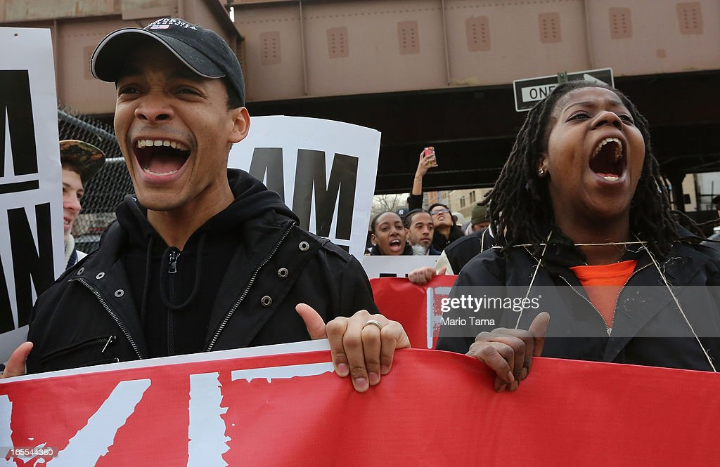 People yell during a protest for better wages for fast food workers while marching to a McDonald's restaurant in Harlem on April 4, 2013 in New York City. Organizers said hundreds of fast food workers were expected to walk off the job today from establishments including Wendy's, McDonald's and KFC to rally for better pay and union rights.