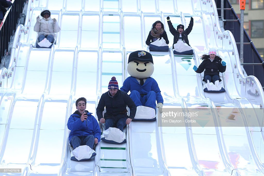 People young and old enjoy the super bowl toboggan run for Activities in times square