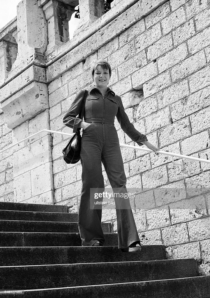 people, young woman on a staircase, stone stairs, handrail, wall, trouser suit, aged 25 to 30 years, France, Loire Valley, Loir-et-Cher, Blois -
