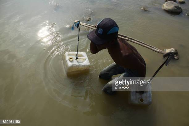 Peoples bathed washed clothes and took waters for daily use in the Cipamingkis river that began to dry at Cibarusa district West Java on Saturday...