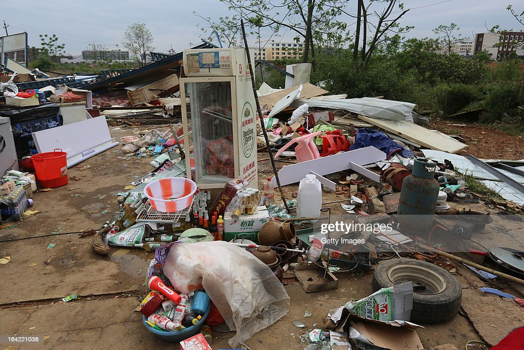 People's belongings lie strewn across the ground on March 20, 2013 in Daoxian, China. Three people have been killed and about 50 others injured after a tornado struck Central China's Hunan Province early on Wednesday morning.