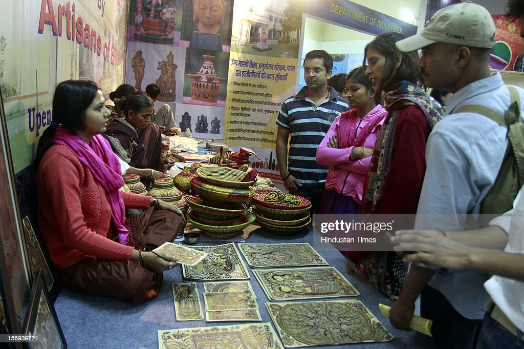 Peoples buying handicrafts items inside Bihar pavilion during 32th India International trade Fair at Pargati Maiden on November 23, 2012 in New Delhi, India. IITF is the one of the largest trade fairs in Asia with participation of more than 7000 exhibitors from India and overseas.