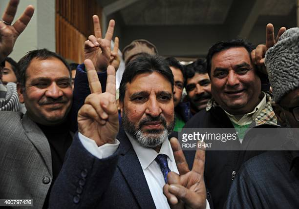 Peoples Democratic Party candidate Altaf Bukhari gestures the victory symbol after defeating Bharatiya Janata Party candidate Hina Bhat during the...