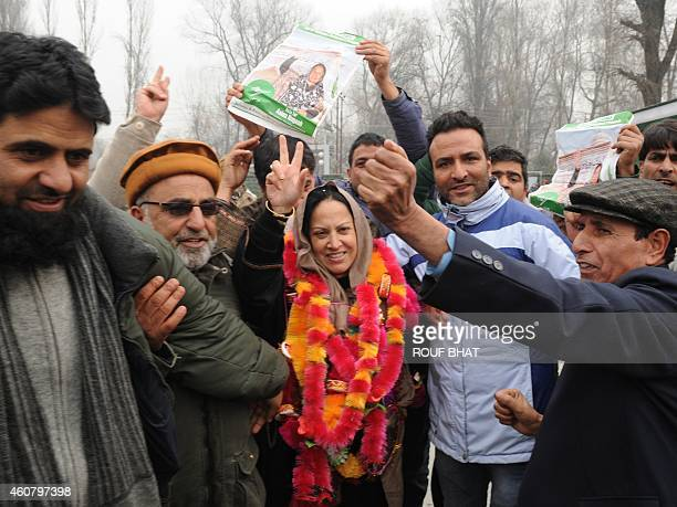 Peoples Democratic Party candidate Asiya Naqash gestures after winning the Hazratbal constituency in Srinagar on December 23 2014 Prime minister...