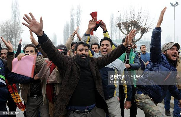 Peoples Democratic Party supporters shout slogans after PDP candidate Mohd Ashraf defeated incumbent Jammu and Kashmir Chief Minister Omar Abdullah...
