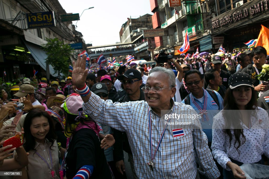 People's Democratic Reform Committee (PDRC) leader <a gi-track='captionPersonalityLinkClicked' href=/galleries/search?phrase=Suthep+Thaugsuban&family=editorial&specificpeople=5734971 ng-click='$event.stopPropagation()'>Suthep Thaugsuban</a> leads a march in Bangkok on January 5, 2014 in Thailand. Thousands of anti-government supporters lined the streets handing money to him to financially support his campaign to oust the government of Prime Minister Yingluck Shinawatra. Thailand's political crisis has continued for over two months with elections going ahead for February 2nd and a planned mass shutdown of Bangkok on January 13th.