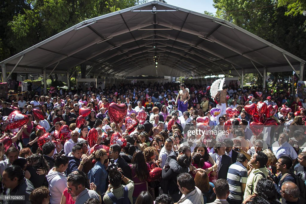 People's demonstrate with red balloons during the Valentine 's Day against abuse and violence against children on February 14, 2013 in Mexico City, Mexico.
