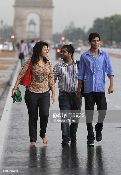 Peoples enjoying the pre monsoon rain after hot summer day at Rajpath on June 6 2013 in New Delhi India Rain and strong winds lashed the capital...