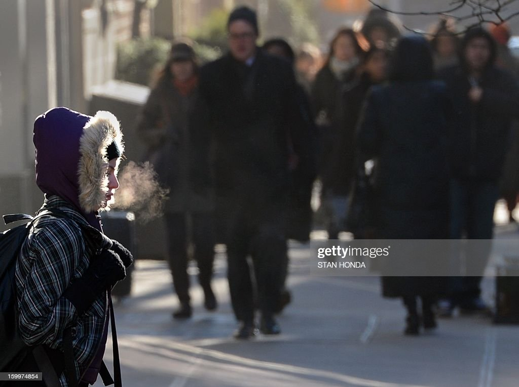 People's frozen breath can be seen in the early morning as they walk on the Upper East Side of Manhattan January 24, 2013 in New York as cold continues to grip the northeast. From the midwest to the East coast freezing temperatures have be responsible for several deaths. AFP PHOTO/Stan HONDA