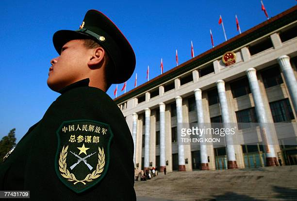 A People's Liberation Army soldier stands guard at the Great Hall of the People during the 17th Communist Party Congress in Beijing 21 October 2007...