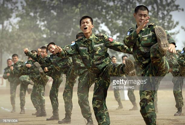 People's Liberation Army soldiers deployed for United Nations peace keeping missions show self defense skills at their base in China's central Henan...