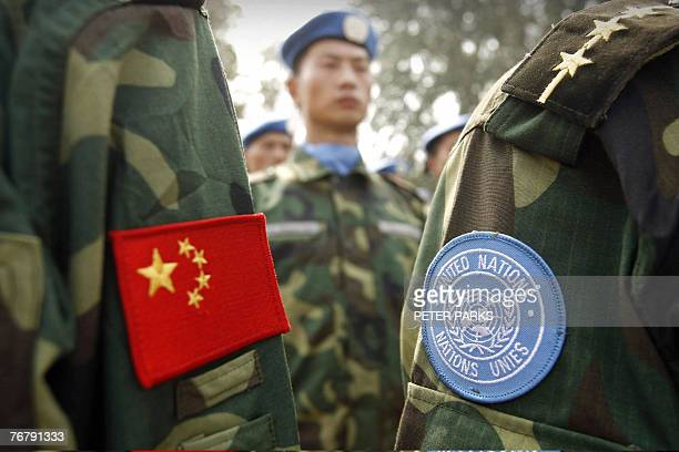 People's Liberation Army soldiers deployed for United Nations peace keeping missions line up at their base in China's central Henan province before...