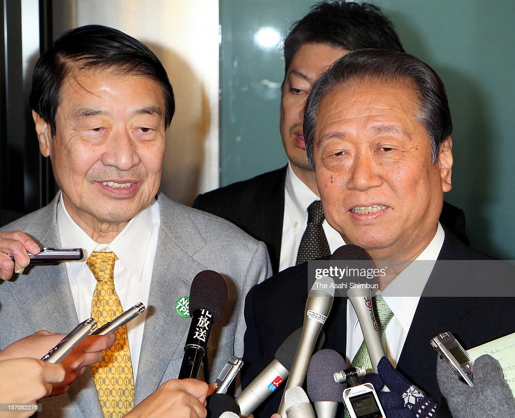 People's Life First Party leader <a gi-track='captionPersonalityLinkClicked' href=/galleries/search?phrase=Ichiro+Ozawa&family=editorial&specificpeople=680192 ng-click='$event.stopPropagation()'>Ichiro Ozawa</a> (R) and co-leader of The Party that anti TPP (Trans-Pacific Partnership), anti nulcear plant and anti consumption tax hike come true, Masahiko Yamada speak to media reporters to announce their merger to Nippon Mirai no Kai (Japan Future Party), formed by anti-nuclear Shiga Prefecture governor Yukiko Kada, on November 27, 2012 in Tokyo, Japan. With Ozawa's party and other small parties joining, 'the third force' will be split into either Japan Future Party or Japan Restoration Party.