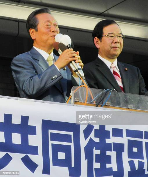 People's Life Party leader Ichiro Ozawa and Japanese Communist Party leader Kazuo Shii take to a street in the northeastern Japan city of Nagaoka on...