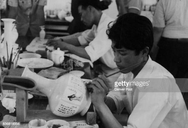 People's Republic of China Entertainment the Arts Steadyhanded painter puts inscription on vase at a porcelain works in Shaoxing Credit The Denver...