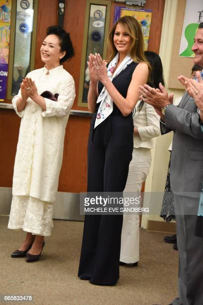 People's Republic of China First Lady Peng Liyuan and US First Lady Melania Trump visit the Bak Middle School of the Arts at West Palm Beach on April...
