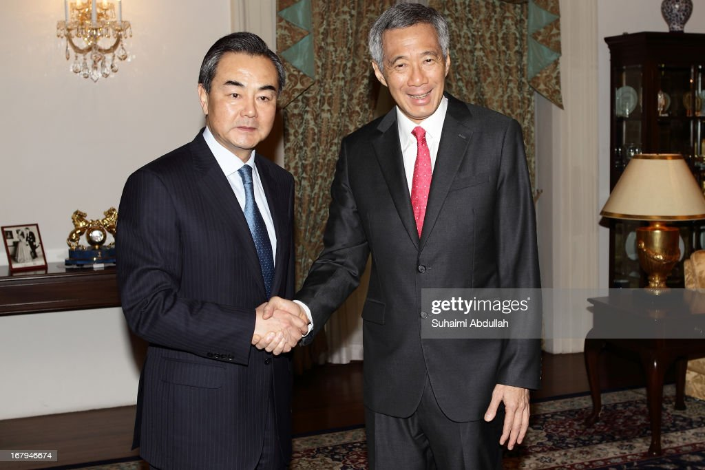 People's Republic of China Foreign Minister, Wang Yi shakes hands with Prime Minister of Singapore, <a gi-track='captionPersonalityLinkClicked' href=/galleries/search?phrase=Lee+Hsien+Loong&family=editorial&specificpeople=3911578 ng-click='$event.stopPropagation()'>Lee Hsien Loong</a> at the Istana during his state visit to Singapore on May, 2013 in Singapore. Wang Yi will be in Singapore for a two-day visit, his first as Foreign Minister.