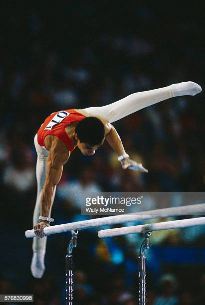 People's Republic of China star gymnist Ning Li careens above the parallel bars during team gymnastics competition at the 1984 Summer Olympic Games...