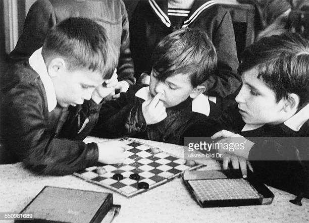 People's Republic of Poland children learning how to play draughts in school