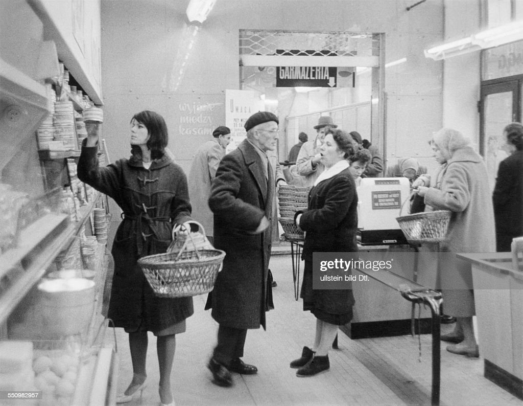 People's Republic of Poland Selfservice shop Women with shopping basket and checkout counter