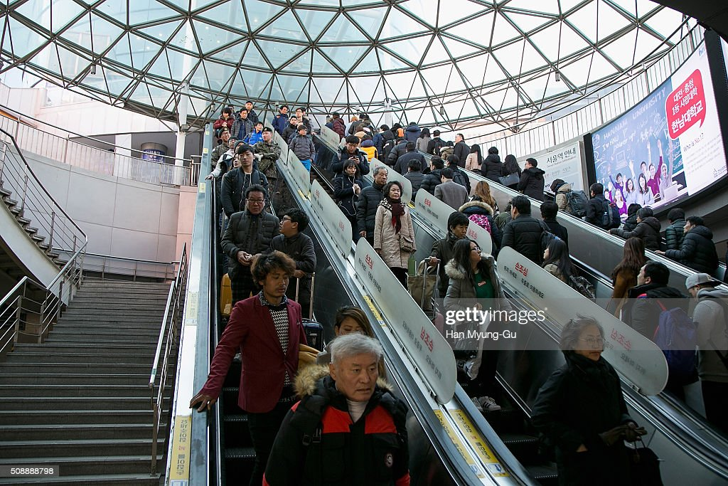Peoples ride an escalator at Seoul Station on February 7, 2016 in Seoul, South Korea. North Korea launched a long-range rocket carrying a satellite on February 7, 2016. The launch is considered by Western experts as part of a program to develop intercontinental ballistic missile technologies, banned by the multiple of past resolutions of the U. N. Security Council against the country. South Korea, the United States and Japan have requested an emergency meeting of the U.N. Security Council.