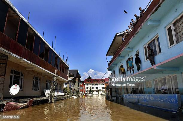 Peoples standing in the second floor of the building as the building submerged in flood waters on September 11 2014 in Srinagar India More than 50000...