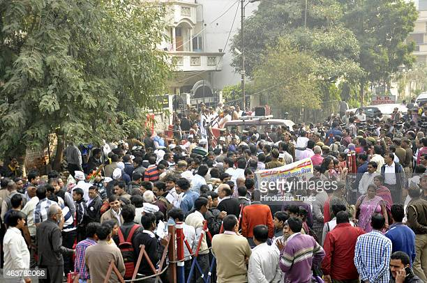 Peoples waiting outside during janta darbar at party's Kaushambi office on February 18 2015 in Ghaziabad India This is first public interaction of...