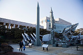 Peoples walk past a display of model missiles including a North Korean ScudB at the War Memorial of Korea on February 7 2016 in Seoul South Korea...